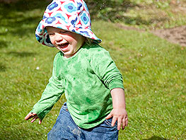 child laughing at play in garden